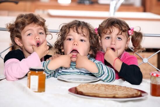 little kids eating pancakes